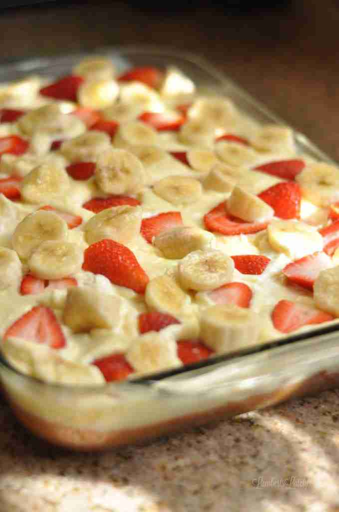 This recipe for Strawberry Banana Poke Cake is an easy recipe made with rich banana pudding and fresh strawberries.