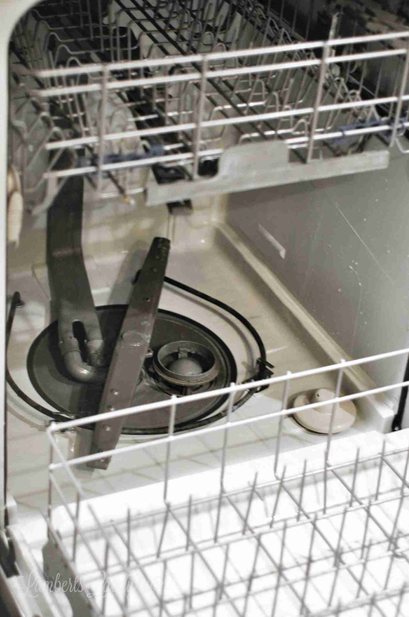 This post shows how to deep clean a dishwasher with vinegar and baking soda - see how to remove the filter and make your dishwasher so much more efficient when cleaning and drying!