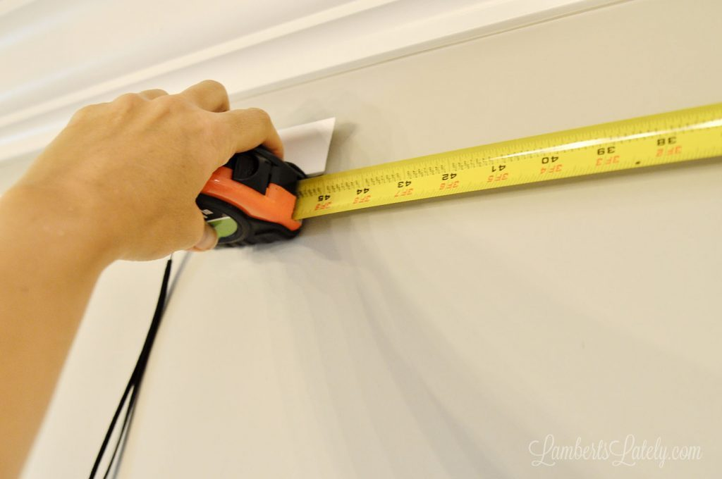 Check out this easy DIY for making existing crown molding look thick! Simply installing additional trim molding and using a faux painting trick makes simple molding look expensive.