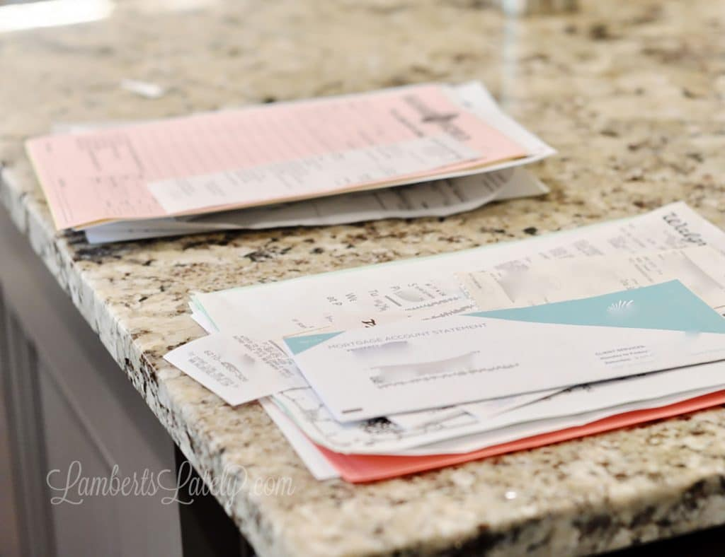 Build a home command center that works! This post includes organization strategies for keeping up with family papers, including school work and receipts - also shows how to digitally organize documents.