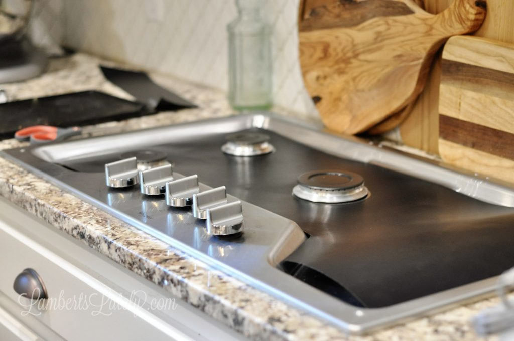 This post shows how to make a DIY Stove Splatter Guard - perfect for keeping kitchens/gas stovetops clean! This guard covers a gas stove to protect stainless steel from spills and stains.